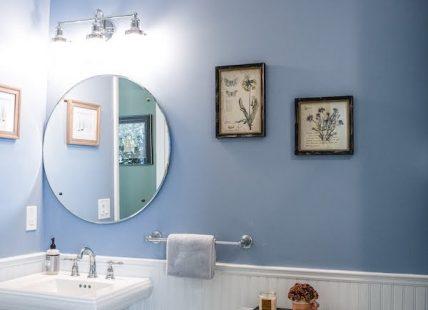 sink & toilet in blue bathroom recently remodeled