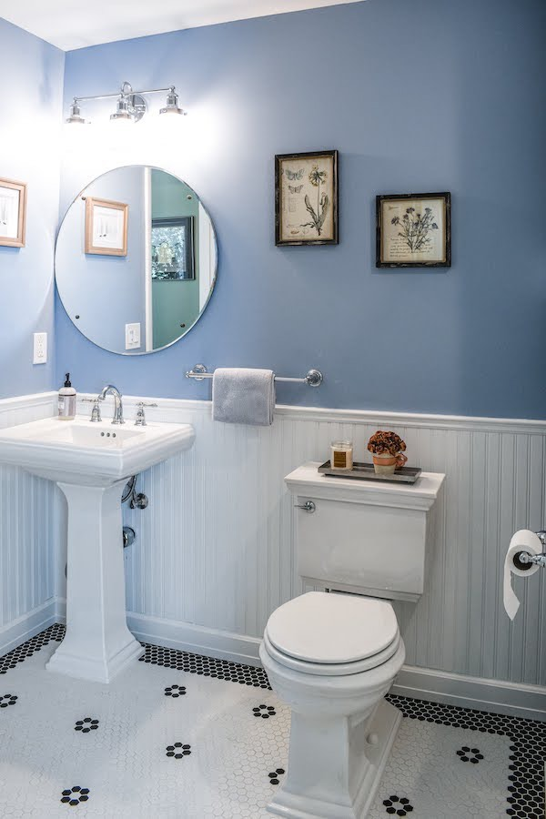sink & toilet in blue bathroom recently remodeled