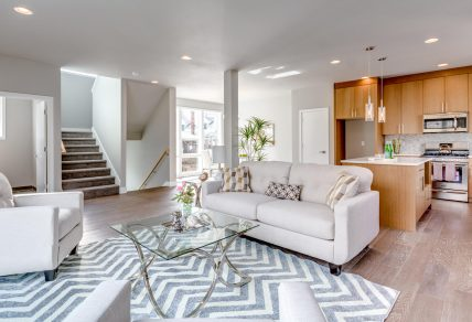 Sitting area with large windows in a modern duplex remodel